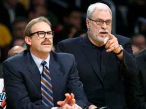 Los Angeles Lakers assistant coach Rambis sits with coach Jackson during their NBA game against the Boston Celtics in Los Angeles