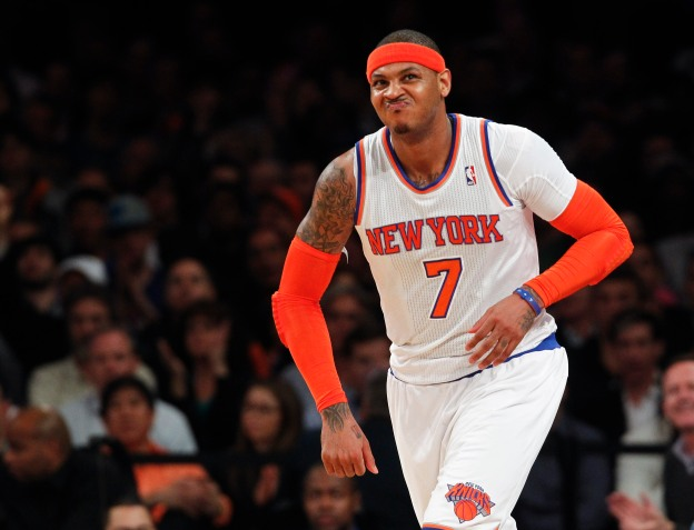 NEW YORK, NY - MAY 7:   Carmelo Anthony #7 of the New York Knicks reacts after making a shot against the Indiana Pacers during Game Two of the Eastern Conference Semifinals of the 2013 NBA Playoffs at Madison Square Garden on May 7, 2013 in New York City. NOTE TO USER: User expressly acknowledges and agrees that, by downloading and/or using this photograph, user is consenting to the terms and conditions of the Getty Images License Agreement. (Photo by Jeff Zelevansky/Getty Images)